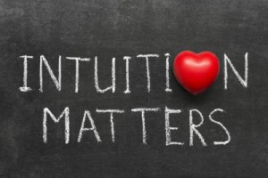 intuition matters phrase handwritten on blackboard with heart symbol instead of O